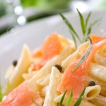 3769589-Closeup-of-plate-of-Smoked-Salmon-Penne-tube-shaped-pasta-with-cappers-tarragon-and-cheese-creamy-sa-Stock-Photo